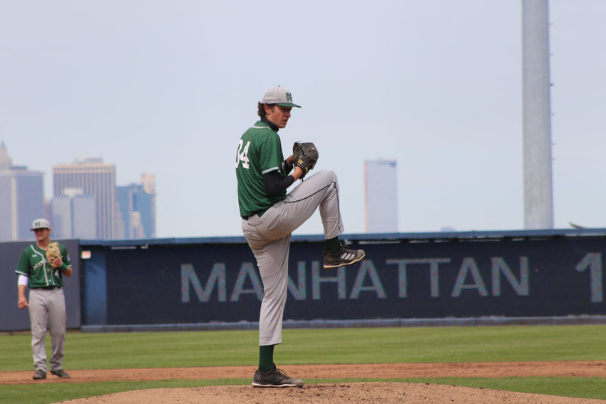 John Cain, Manhattan's towering 6-foot-10 left-hander, blends right in with the lower Manhattan skyline as he warms up prior to the Jaspers' MAAC tournament win over Marist. Cain fanned nine in a 6-2 Manhattan win.
