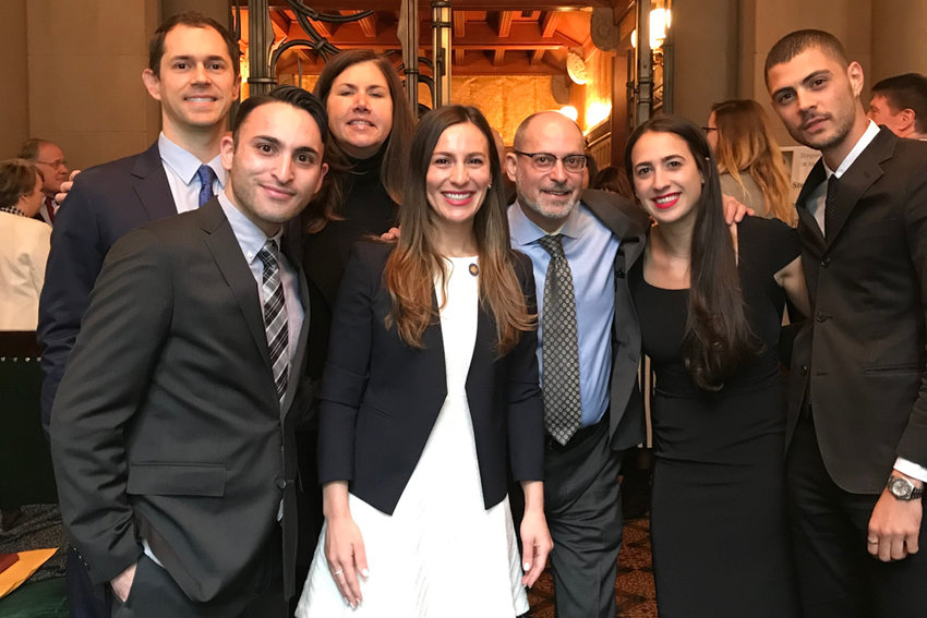 Christian Amato, second from left, and Andrew Mutnick, center, smile for a photograph with state Sen. Alessandra Biaggi. Mutnick resigned as Biaggi's chief of staff May 10, and Amato was fired from his deputy position May 31.
