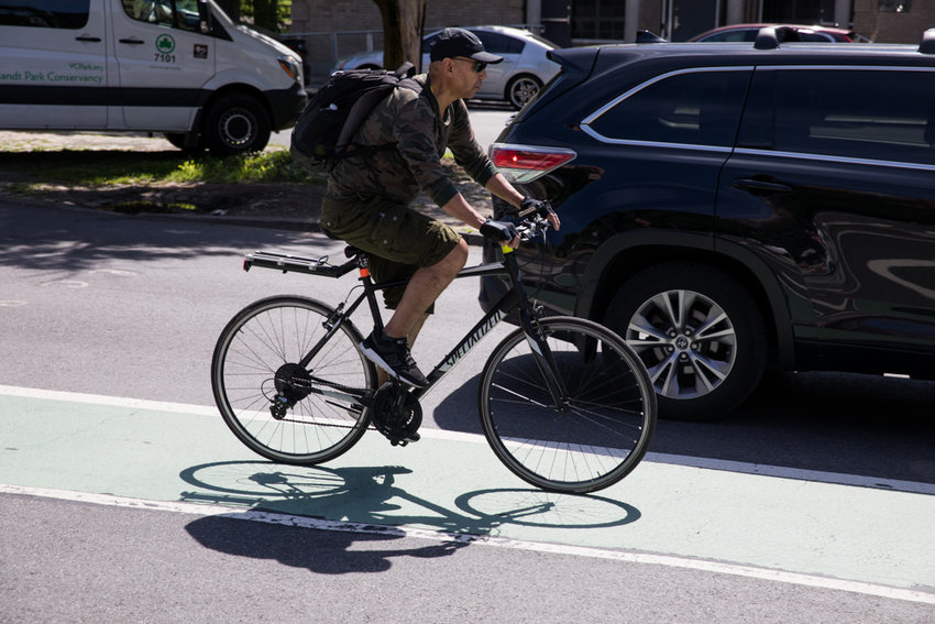 A cyclist rides south on Broadway in a bike lane — lanes which are a contentious issue for some community members, especially since the city's transportation department wants to add more lanes to Mosholu Avenue between West 254th and West 256th streets.