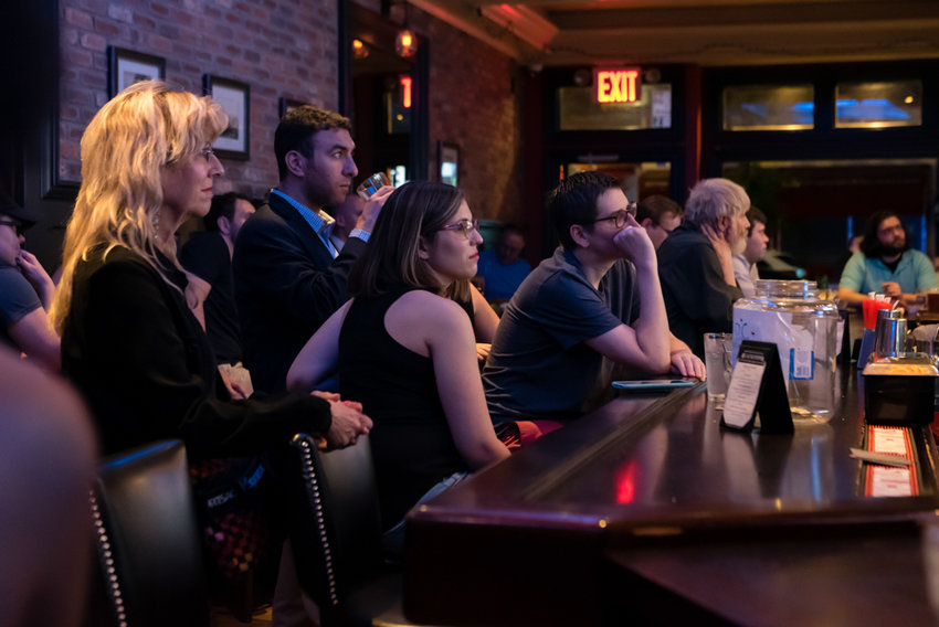 City council candidate Eric Dinowitz, second from left, watches the second night of the Democratic presidential debate with Morgan Evers, center, and other members of the Benjamin Franklin Reform Club, at Blackstone Bar & Grill on Riverdale Avenue.