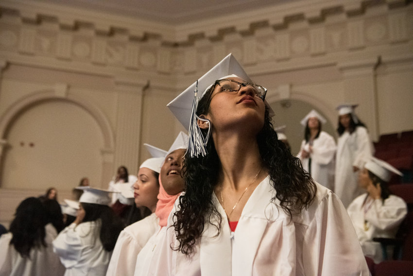 Graduating seniors from Marble Hill School for International Studies prepare for the procession in the College of Mount Saint Vincent's Hayes Auditorium.