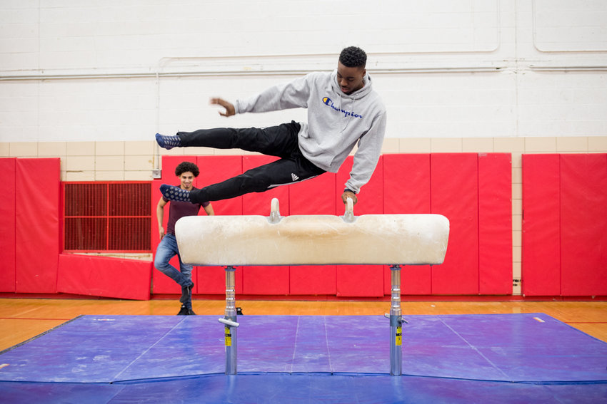 Former JFK gymnast Jermaine DaCosta shows off his skills on the pommel horse, an event he won the PSAL individual championship this past season.