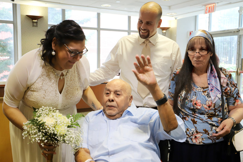 Ruben Alers Sr., a resident of the Plaza Nursing and Rehabilitation Center, waves during the wedding of his son, Ruben Alers Jr., and his wife Angelica Bermudez, who traveled from the west coast to have their wedding ceremony especially for him.