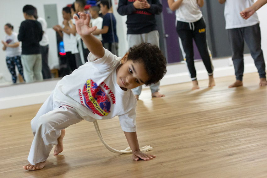 A young capoeirista trains in ABADÁ-Capoeira Bronx near the West 242nd Street subway station. Practitioners of capoeira traditionally wear white.