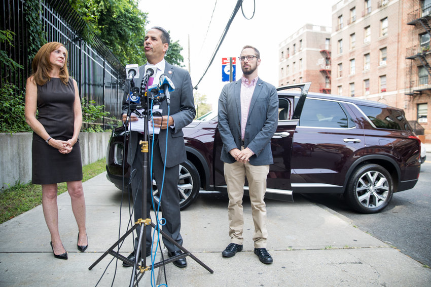 Councilman Fernando Cabrera laments the deaths of twins in a hot car on West Kingsbridge Road on July 26 during a press conference near the site of the incident. Cabrera says he intends to explore what it would take to make leaving children in hot cars illegal.
