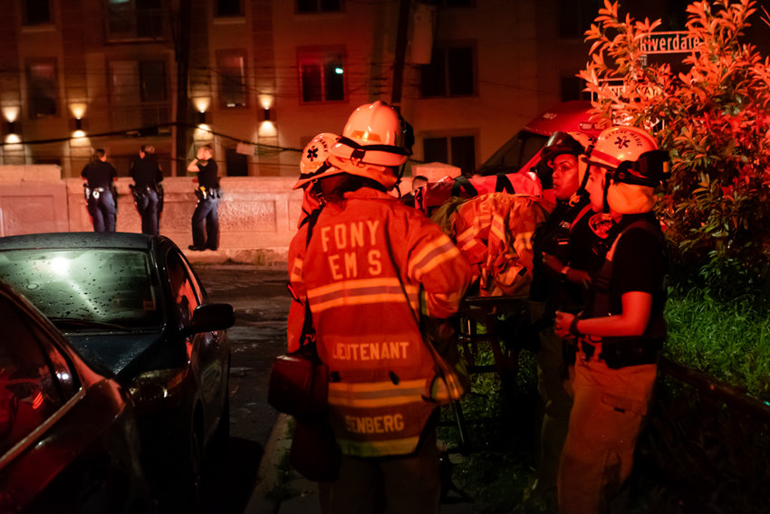 Firefighters and police officers respond to a fire in the early morning hours of Aug. 1 at 511 W. 232nd St. One resident suffered a minor arm injury, but refused medical attention.