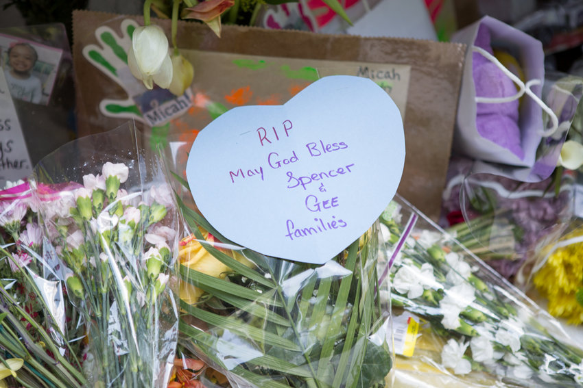 A paper heart affixed to a bouquet of flowers memorializes the 2017 deaths of toddler siblings Olivia and Micah Gee. Two years later, their mother, Jade Spencer, was arrested and charged with two counts of manslaughter.