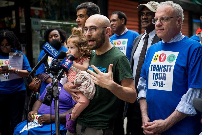 Danny Pearlstein, policy and communications director for Riders Alliance, calls on the Metropolitan Transportation Authority to do more to fix the city's subway system at the start of the Riders Respond Transit Tour on Aug. 7. Pearlstein feels the MTA's 'cost neutral' approach to fixing the borough's beleaguered bus network will largely be ineffective.