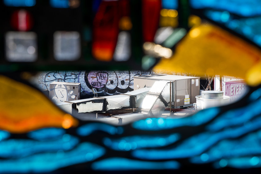 The top of a building can be seen through a hole in a stained glass display on the downtown side of the West 231st Street 1 train station. State comptroller Thomas DiNapoli released a report on the city's subway system revealing there's not a single train station in the Bronx that's in good repair. The MTA disagrees saying many of the needed changes are just cosmetic.