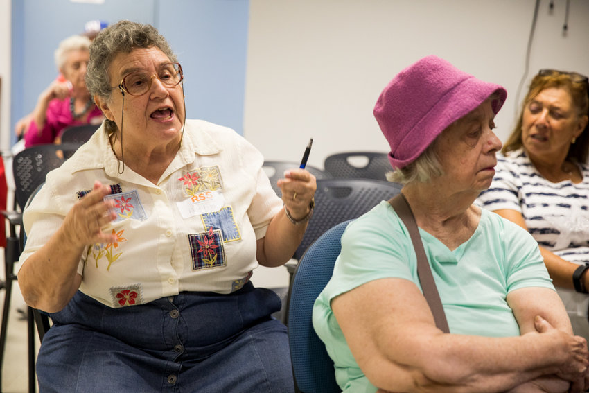 Ruth Fisch asks a question of state Sen. Alessandra Biaggi during an information session at RSS-Riverdale Senior Services. The senior center, which is celebrating its 45th anniversary, is often a forum for the neighborhood's older community to connect with local elected officials.