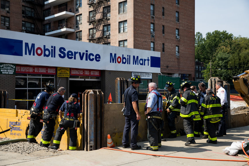 Firefighters respond to a fire in a construction lot near the corner of West 251st Street and Broadway.