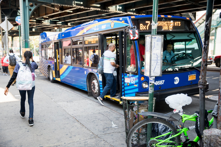 A southbound Bx7 bus picks up passengers at West 225th Street and Broadway. The city's transportation department has proposed adding a bus lane to the southbound side of Broadway between West 228th and West 225th streets.
