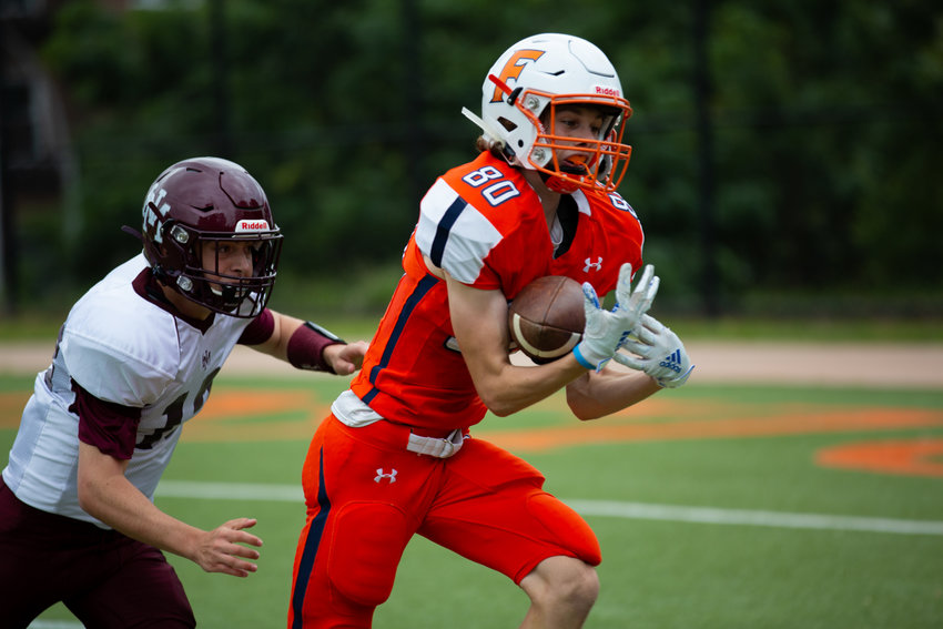 Fieldston's Luke Hanson hauls in a big-gainer during the Eagles' 34-22 victory over Horace Mann. Hanson had the game's first touchdown thanks to a 20-yard pass from Jake Horowitz.