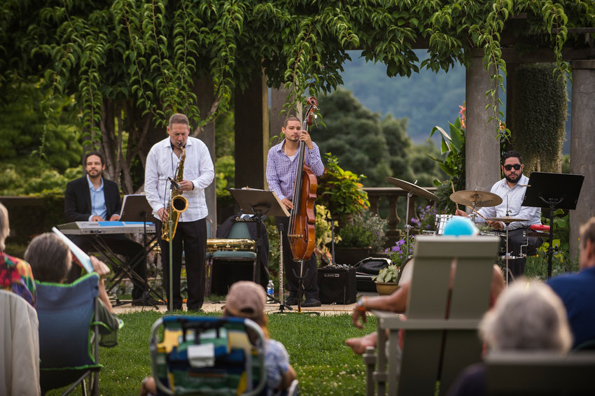 The Mitch Frohman Latin-Jazz Quartet performs at one of Wave Hill's Sunset Wednesdays concerts in 2014. The garden just wrapped up its summer programming for this past year, and looks ahead to upcoming seasons.