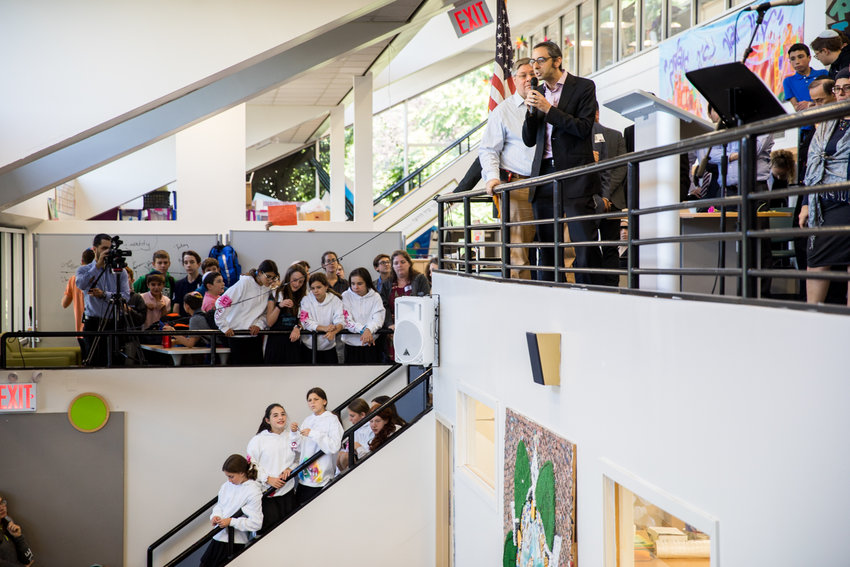 Rabbi Steven Exler speaks to students, faculty and staff during an assembly at Salanter Akiba Riverdale Academy. Exler and other Jewish community leaders spoke at the school to inspire hope at the end of a turbulent week in which Jonathan Skolnick, an associate principal at SAR, was arrested on charges of sexual exploitation of a minor, extortion, coercion and more.