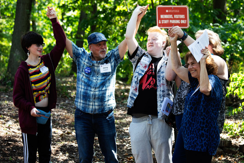 Jerry Goodman, second from left, cheers with attendees of a flag unveiling ceremony for the organizations PFLAG and Black Lives Matter at the Riverdale-Yonkers Society for Ethical Culture on Sept. 22. Goodman and his wife Mimi worked to establish the Bronx's first PFLAG chapter at Ethical Culture.