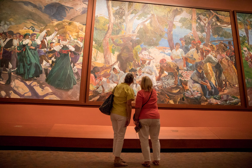 Visitors to the Hispanic Society of America take in Joaquín Sorolla y Bastida's 'Vision of Spanish,' a massive series of 14 paintings depicting Spanish life in the early 20th century.
