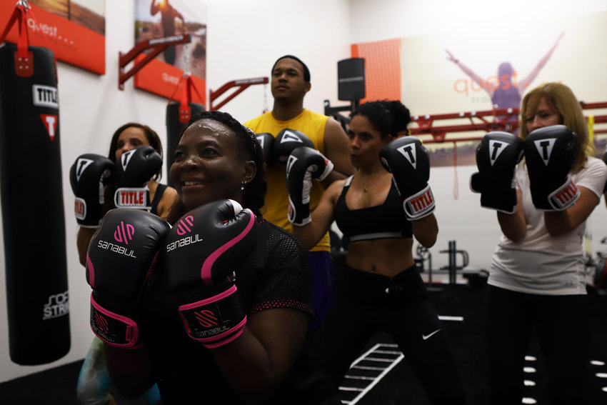 Aliette Leung leads a kickboxing class in the Quest Training Studio at The Riverdale Y, using space that was previously home to a once-popular racquetball court.