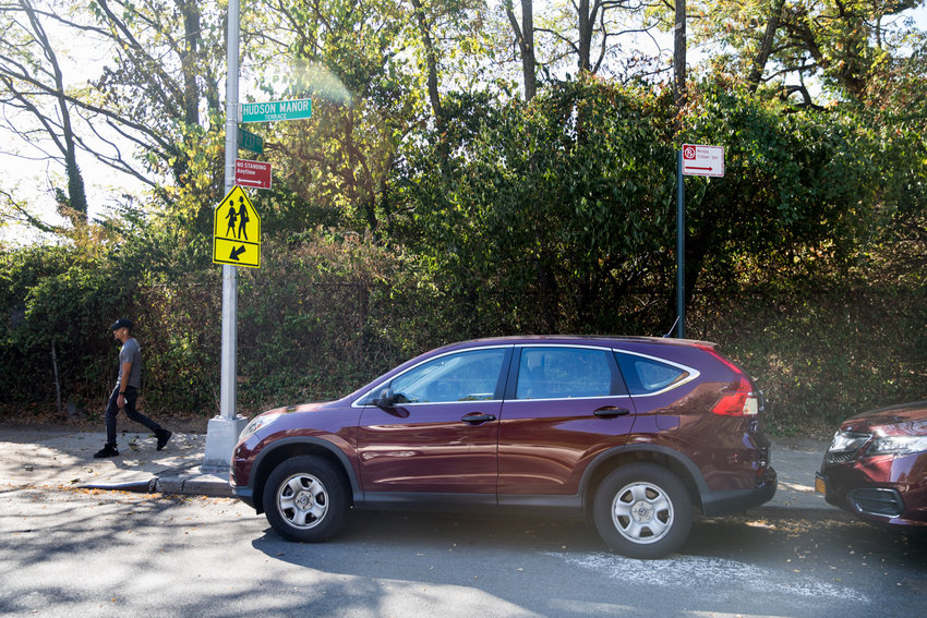 A car is parked in an area designated 'no standing anytime' along Hudson Manor Terrace. The city's transportation department recently removed approximately 14 parking spots between West 236th and West 239th streets to make way for new crosswalks.