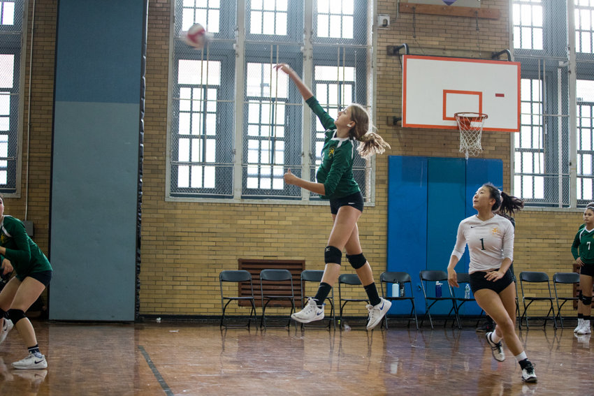 Bronx Science junior Anya Lollos soars high to register one of her 10 kills during the Wolverines' 25-18, 25-18 victory over Walton last week.