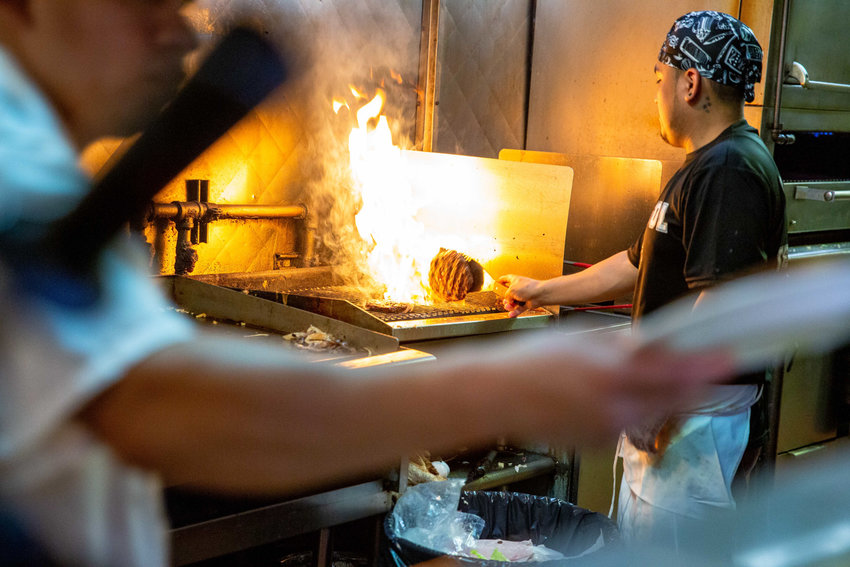 Cooks prepare hamburgers, a staple of any classic American restaurant, at Dale Diner on West 231st Street, which has been open since 1975.