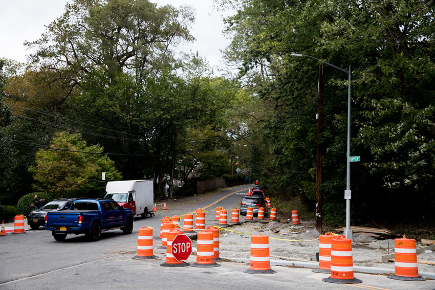 A pickup truck drives north on Palisade Avenue past Kappock Street where curbs are being extended in an attempt to make the intersection safer for pedestrians.