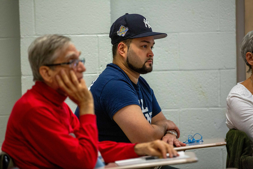 George Diaz Jr., a Norwood resident and member of Bronx Progressives, listens as Councilman Andrew Cohen talks about the city charter process during a forum at Manhattan College last Saturday. Diaz is running a primary campaign against Assemblyman Jeffrey Dinowitz.