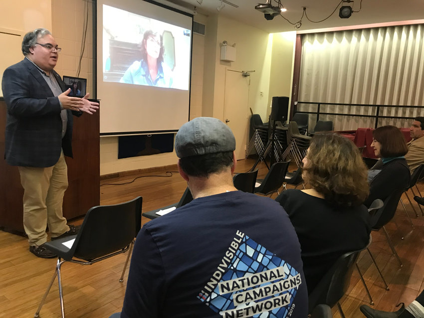 With Danielle Brian, executive director of the Project on Government.Oversight looking over his shoulder, U.S. Rep. Eliot Engel staff chief Bill.Weitz shares an inside look on what the impeachment of President Donald.Trump would look to a group gathered Sunday from Northwest Bronx Indivisible.