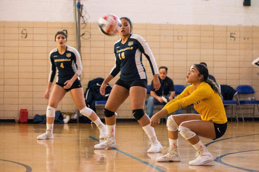 Riverdale/Kingsbridge Academy's Julianne Fernandez records one of her 17 digs in the Lady Tigers' straight-set victory over Lehman that clinched the Bronx A-2 Division title.