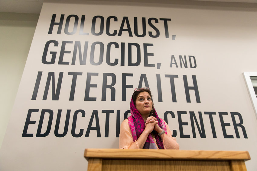 Manhattan College religious studies professor Mehnaz Afridi speaks during the opening of the Herman and Lea Ziering Archive Collection at the school's Holocaust, Genocide and Interfaith Education Center. The collection brings together materials related to the prosecution of Nazis after World War II. The Zierings were Holocaust survivors, and Herman was a Nazi hunter.