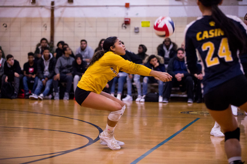 RKA co-captain Julianne Fernandez digs out a shot from Bayside during the Lady Tigers' PSAL playoff loss to the Lady Commodores.
