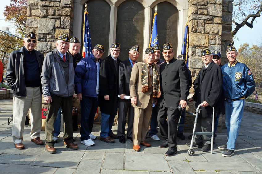 Riverdale American Legion Post 1525 held a Veterans Day Ceremony at the Riverdale Monument on Nov. 11. Cmdr. Isaac Cortes, fourth from right, led the proceedings, which drew approximately 50 community members.
