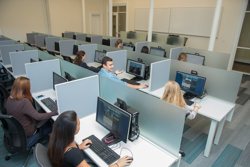 Students research on computers in a new space in Fishlinger Center at the College of Mount Saint Vincent.