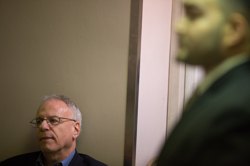Assemblyman Jeffrey Dinowitz listens as his primary challenger, George Diaz Jr., makes his case to earn the endorsement of the Benjamin Franklin Reform Democratic Club at its Nov. 20 meeting.