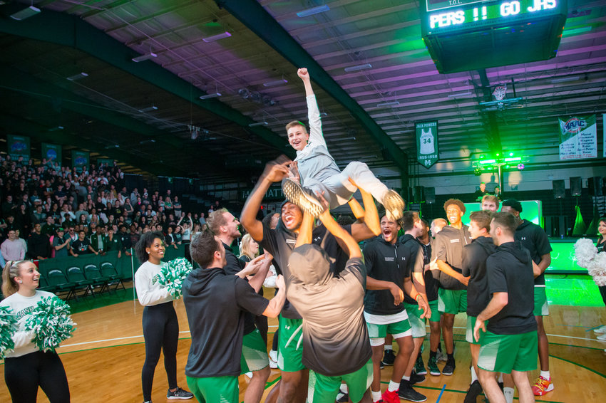 Brandon Boyce, the younger brother of Manhattan College basketball player Jesse Boyce, gets tossed in the air during the Jaspers' Manhattan Madness event earlier this season.