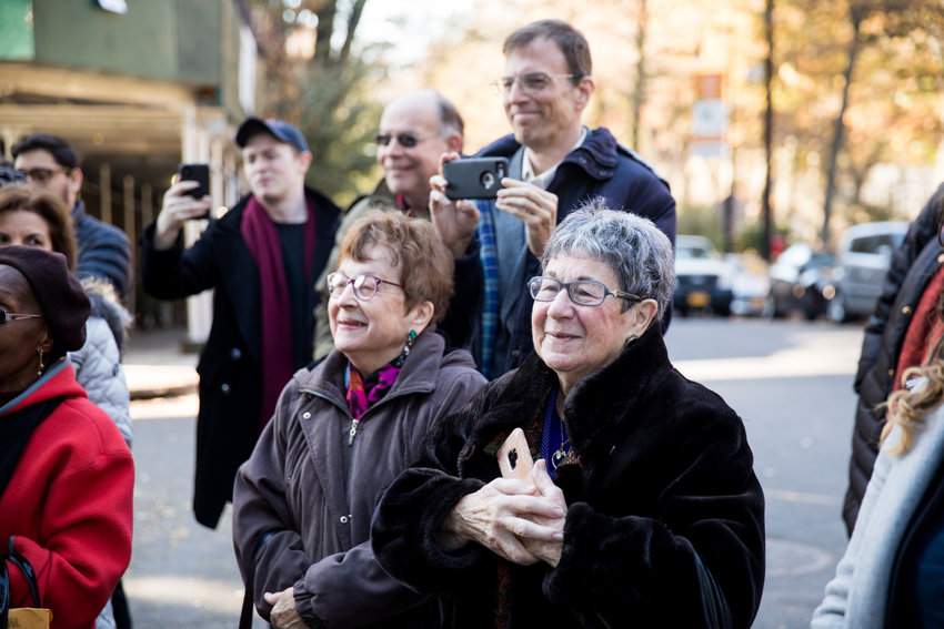 Marsha Heller, right, Louise Scribner and Andrew Scribner, center, attend a street co-naming ceremony for William J. Scribner Way on the corner of Hillman Avenue and Van Cortlandt Park South. Louise, William Scribner's first wife, and Marsha, his second, saw the ceremony as a fitting culmination of his legacy, which included his founding of the Bronx Arts Ensemble, which is headquartered nearby.