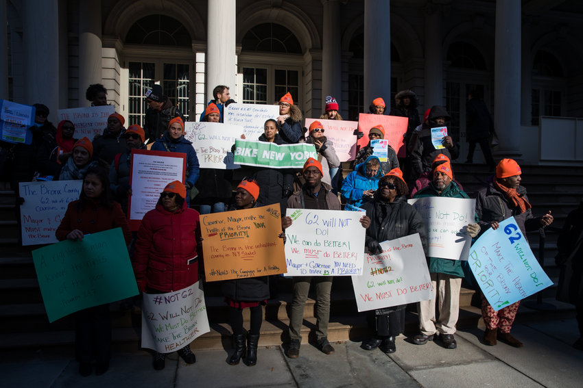 Members of Bronx Health Reach and other advocacy groups hold a rally on the steps of city hall as part of Not 62 earlier this month. For the second year in a row, the Bronx came last out of all the counties statewide when it comes to health.