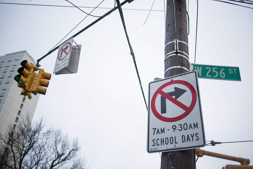 Traffic signs indicate cars cannot turn onto West 256th Street from Mosholu Avenue during early-morning.drop-off on school days. Parents and neighbors have complained of rampant traffic problems during both dropoff and pick-up at P.S. 81 Robert J. Christen School.