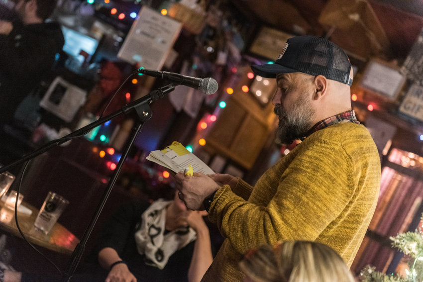 Timothy Donnelly reads a poem from his recently published book 'The Problem of the Many' at the 10-year anniversary of the Poor Mouth Writer's Night at An Beal Bocht Cafe on Dec. 11.