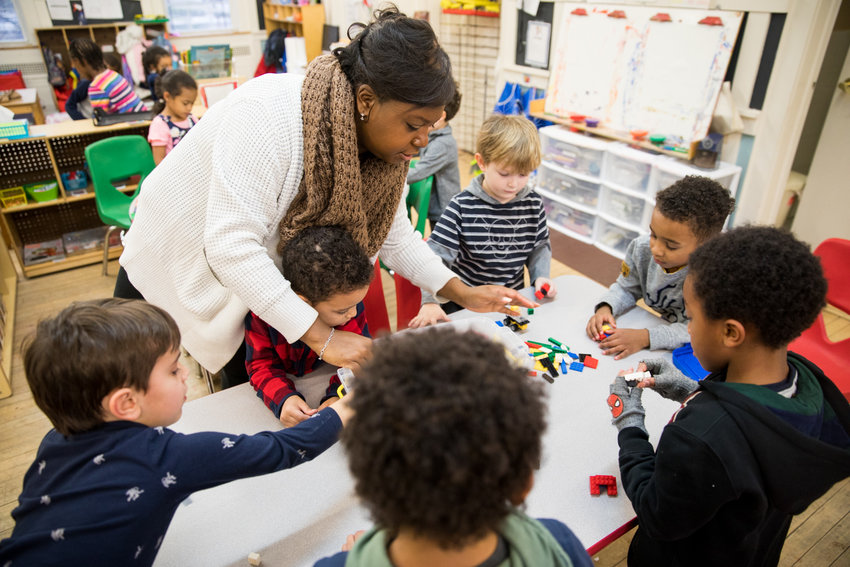 Sabrina Hines helps children play in the after school program at Riverdale Neighborhood House. Hines works as the organization's after school program director. RNH is currently looking for its next executive director.