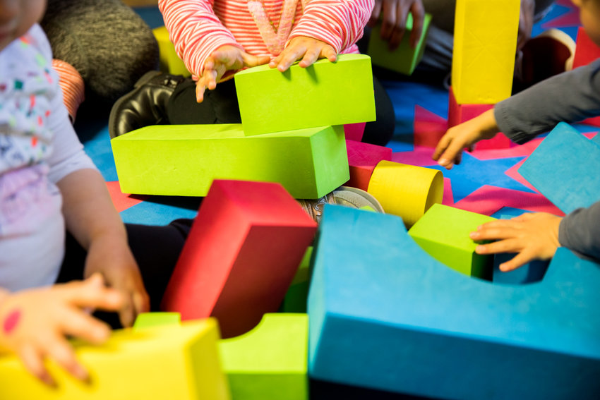 Children play with blocks at Rodi Daycare Center. Child care is often expensive, but U.S. Sen. Kirsten Gillibrand is hoping to mitigate some of that with legislation aimed at making it more affordable for students who have children.