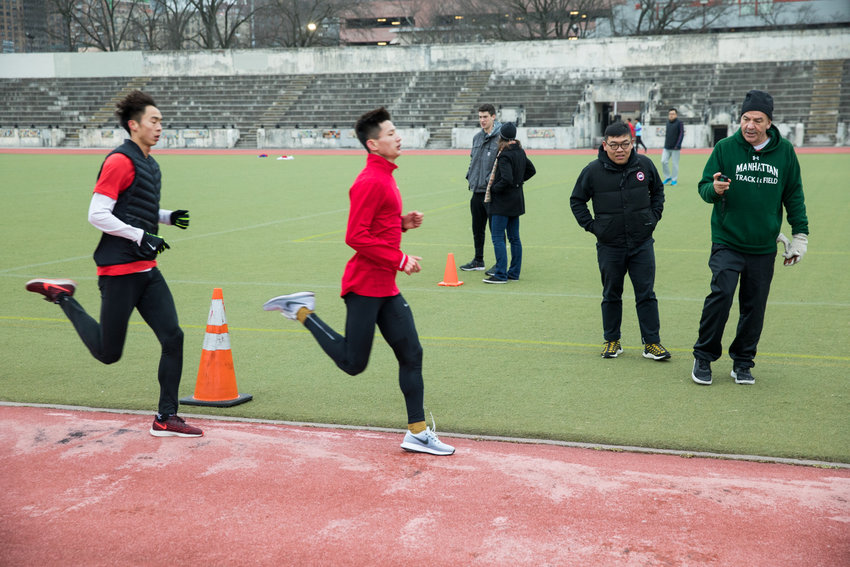 Manhattan College running coach Matt Centrowitz clocks runners from China during a training session at Van Cortlandt Park. A nationally renowned running coach, Centrowitz is training the Olympic-level athletes on his home turf.