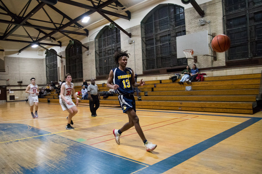 Riverdale/Kingsbridge Academy's Kai Parris loses the ball out of bounds, but that was about the only thing not going his way as he scored 28 points in a convincing victory over American Studies.