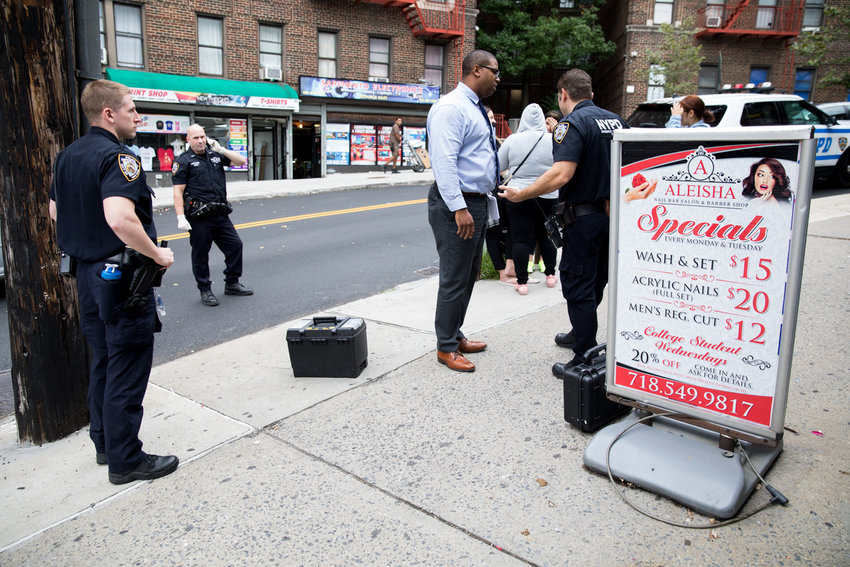 Police officers and detectives respond to a string of burglaries at three businesses on West 238th Street near Bailey Avenue last September. The 50th Precinct saw a slight uptick in crimes last year, but some of the more violent kinds of crime like murder and gun-related incidents actually fell.