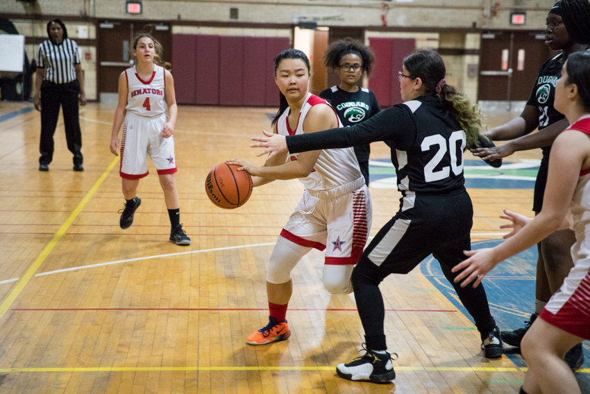 American Studies junior guard Suzuki Lin had a game-high 17 points in the Senators' rout of Marie Curie last week.