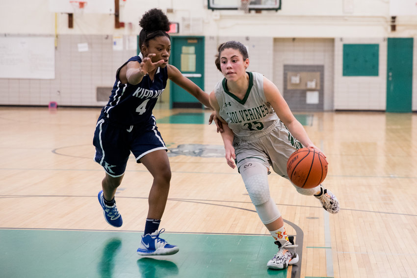 Bronx Science junior guard Carolina Lopez works her way around a KIPP defender for two of her 13 points in the Wolverines' 56-27 victory.