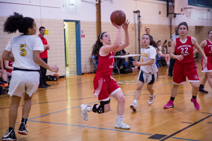 Jacqui Harari scores two of her 10 points in American Studies' win over RKA last week, a game before the Senators downed old nemesis Tuitt 57-23.