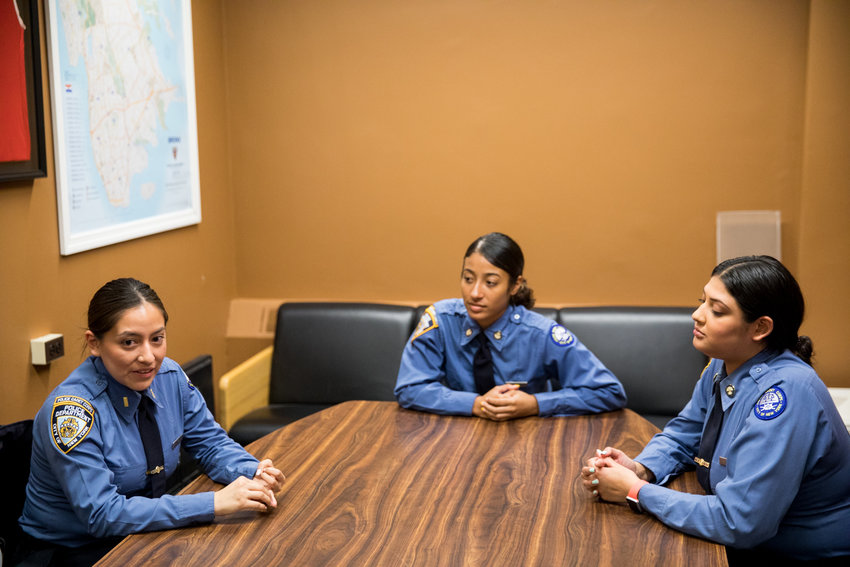Lesly Diaz, left, talks about her experience as a member of the Police Cadet Corps at the 50th Precinct alongside Emily Cruz, center, and Caroline Azeez. The corps acts as sort of a paid internship for college students interested in becoming police officers after graduation.
