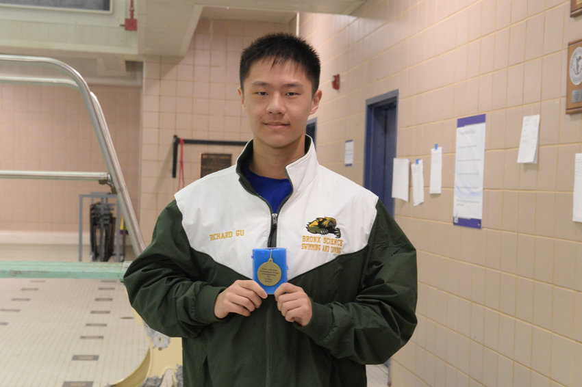 Bronx Science diver Richard Gu displays the medal he earned by finishing first in the Public School Athletic League's city championships this season.