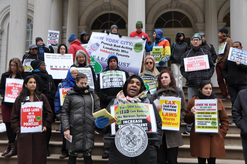 Tina Johnson, healthy homes organizer for We Act for Environmental Justice, speaks at a November rally calling for more protections for tenants exposed to lead dust. NYCHA has yet to test all of its facilities for lead.